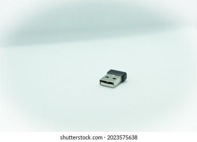 A black color USB dongle for data transmission.