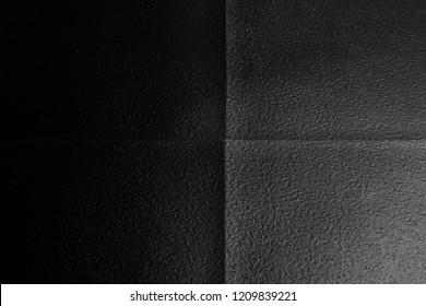 Black color vinyl tile floor texture background