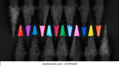 black, colored pencils, on black background, Shallow depth of field