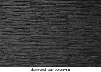 black colour dark brick wall natural rock texture background surface