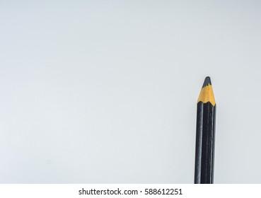 black Colour pencil on white background