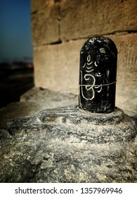 Black colour Shivalingam at the ghats of Varanasi in a temple near Ganges river. Om sign shivalingam isolated near the Kashi Vishwanath Temple in Varanasi.