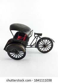 A Black Coloured Local Indonesian Transportation Vehicle with White Background Side View. An Isolated Cycle Rickshaw with Red Colored Cushion Seat