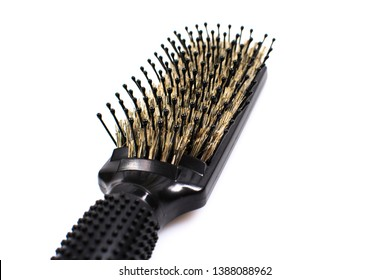Black comb isolated on white background. Comb with natural wild boar bristles