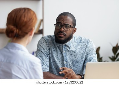 Black company owner searching for workforce. African executive manager listening candidate female consider her unsuitable for job position. Hr, bad first impression and failing work interview concept