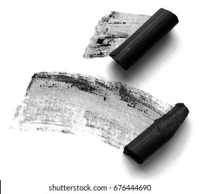 Black compressed charcoal sticks for drawing on white background