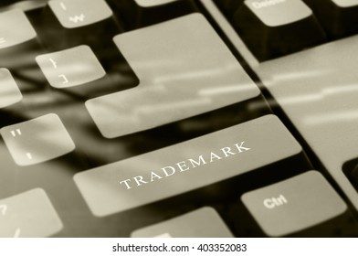 Black computer keyboard with Trademark word button with soft focus.