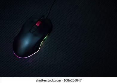 Black computer mouse Multicolour lights Black background