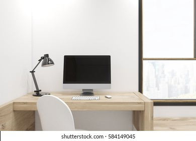 Black computer screen is standing on a wooden desk in an office with white walls and a large window. 3d rendering, mock up