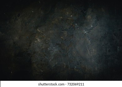 Black concrete background.