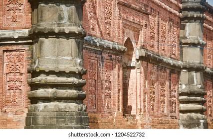 Black concrete pillars of an old architectural building unique photo