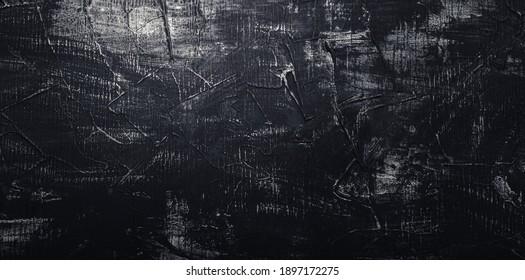 Black concrete wall. Texture old dark stone background. Vintage anthracite wallpaper. Old scratched dark grunge plaster texture. Black cement background with white scuffs. Long Web banner