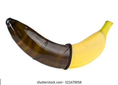 Black condom and banana isolated on white background. Safe sex concept.