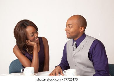 Black coulple sharing a romantic, cup of coffee together