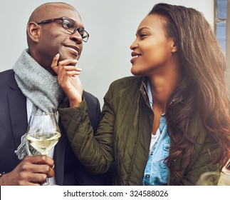 Black couple having a good time on a cafe in the spring