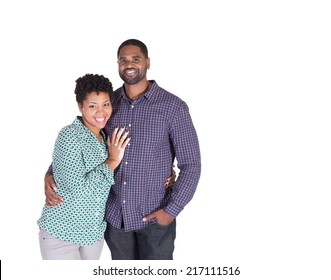 Black couple smiling and holding each other isolated on white