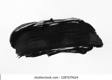 Black cream smear on white background, charcoal or clay facial mask, beauty and skin care design element
