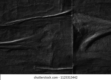 Black creased crumpled paper background texture surface old torn ripped posters grunge backdrop