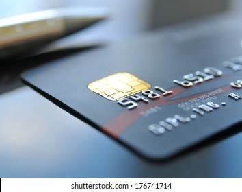 Black credit card with ball pen