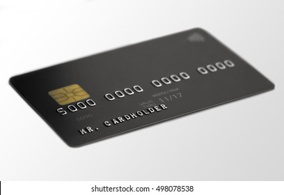 Black credit card on white background, depth of field, cardholder name