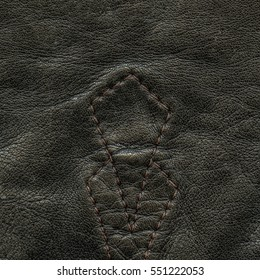 black crumpled leather texture closeup,stitches. Useful for background