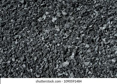 Black crushed basalt.