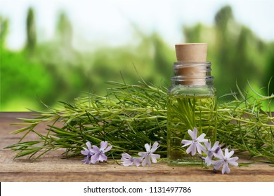 Black cumin oil with seeds on wooden table