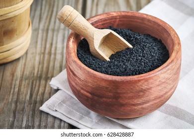 Black cumin seed (Nigella sativa) in wooden bowl