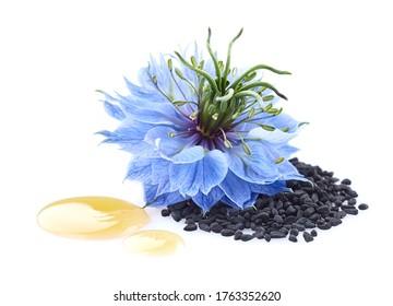 Black cumin seeds with nigella sativa flower in closeup