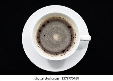 Black cup of coffee on a black background