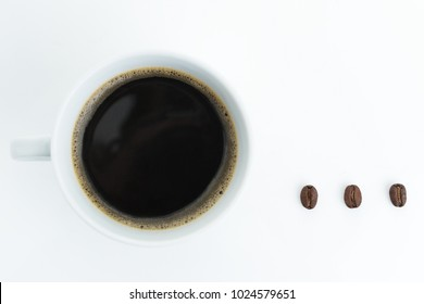 Black cup of coffee with three coffee beans as ellipsis punctuation