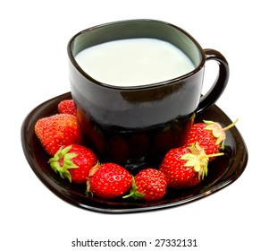 black cup with milk and strawberries
