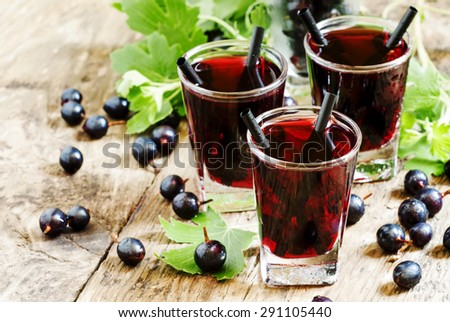 Black currant cocktail with berries, selective focus