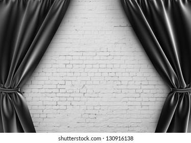 black curtain and brick wall