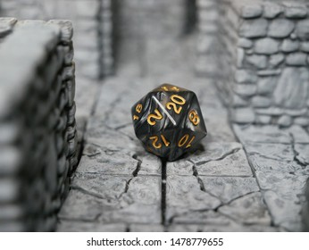 Black D20 Dice on 3D Printed Dungeon Tiles for D&D