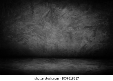Black, dark and gray abstract  cement wall and studio gradient background, space and empty room
