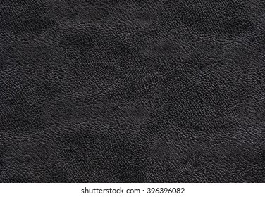 Black dark leather texture background. Black handbag leather. Closeup black  texture skin. Leatherwork structured.
