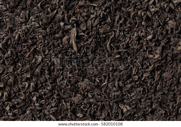 Black dark textured tea background full frame