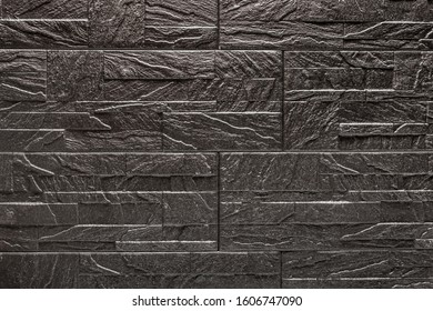 Black decorative stone tile texture with patterns for background