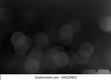 Black Defocused Bokeh twinkling lights Vintage background.