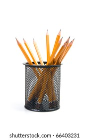 black desk organizer with pencils on a white background.