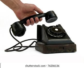 Black dial telephone and hand on a white background