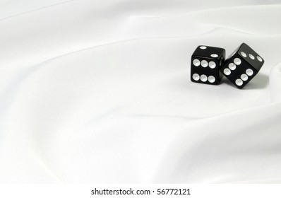 Black dice on white fabric