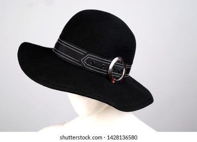 black different alternative models female trilby hat lifeless mannequin stands on head background grey female accessory hat fashion trend textile
