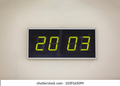 Black digital clock on a white background showing Earth Day