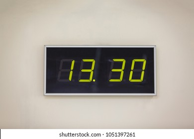 Black digital clock on a white background showing time 13 hours 30 minutes