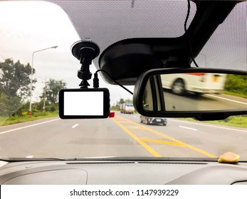 Black digital dashcam camera installed in the car near the rearview camera have many useful for driver when drive on the road.