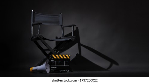 Black director chair and Clapper board or movie Clapperboard with megaphone on black background.use in video production or film cinema industry