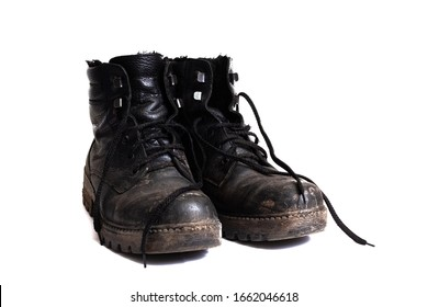 Black dirty men's boots isolated on white background