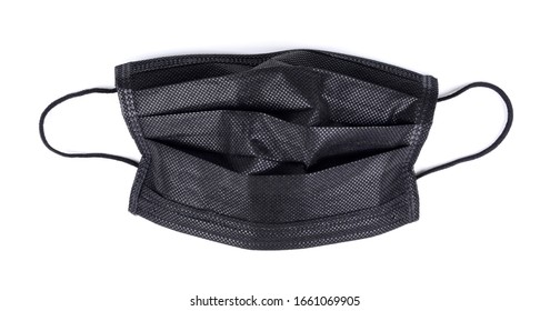 black disposable medical face mask isolated on white